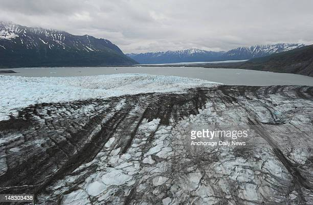 Aerial view from an Alaska Army National Guard UH60L Black Hawk helicopter of Colony Glacier foreground as it flows towards Inner Lake George and...