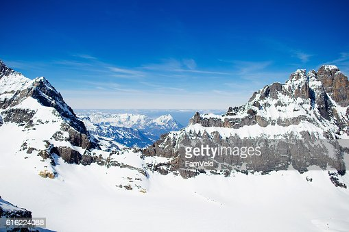 Aerial view from helicopter above glacier in Swiss Alps : Stock Photo