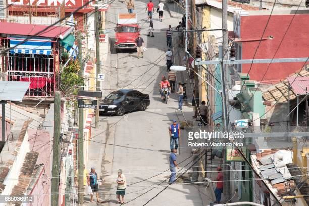 Aerial view from the Pico Steps of the everyday lifestyle or routine in the city Old car in action varied architecture and real people out and about