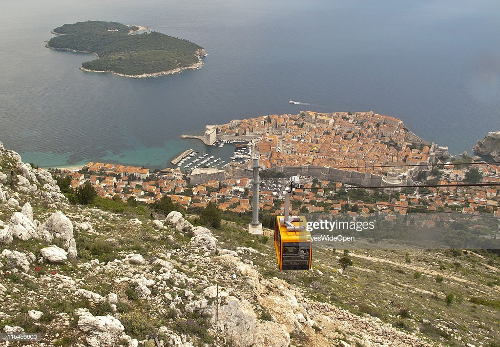 Aerial view from the Srd-Mountain and its cable car of the UNESCO World Heritage Site city of Dubrovnik on the Dalmatian coast of the Adriatic Sea and the island of Lokrum on May 13, 2011 in Dubrovnik, Croatia. The old town is surrounded by a 1,9 km long city wall and called the Pearl of the Adriatic.