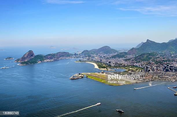 Aerial view, looking at the center of Rio de Janeiro with Sugar Loaf Mountain, left, and Santos Dumont city airport, right, Rio de Janeiro, Brazil, South America