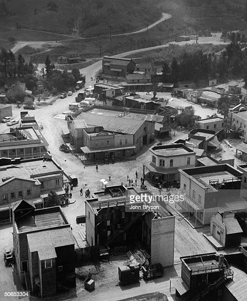 Aerial view of 2 TV Westerns being filmed at once on the Warner Bros lot