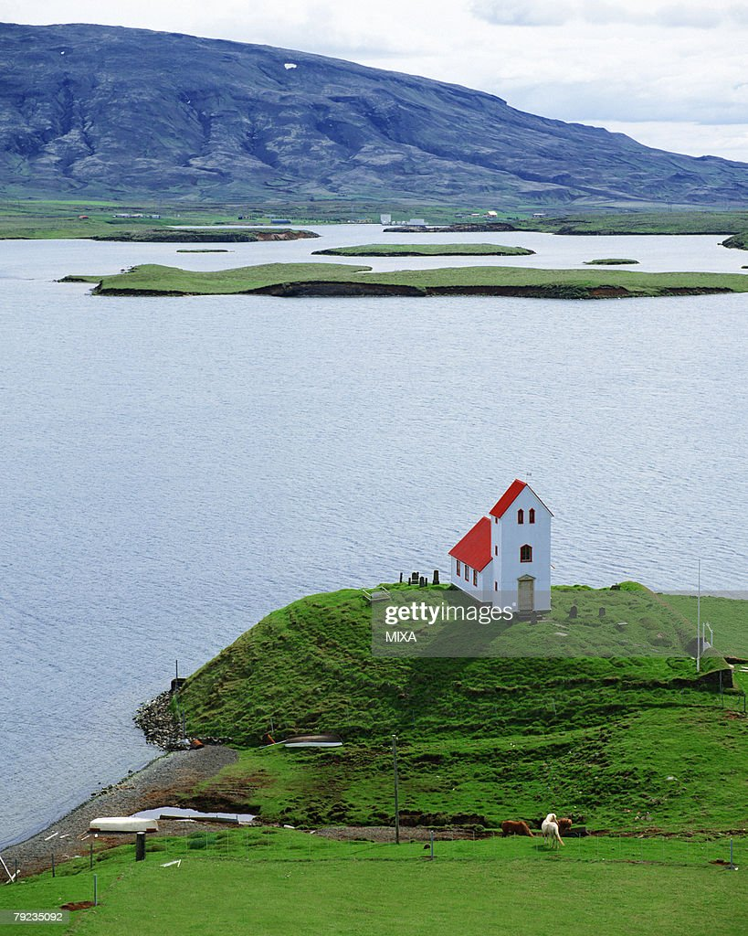 Aerial view of a building located near seacoast, Iceland : Stock Photo