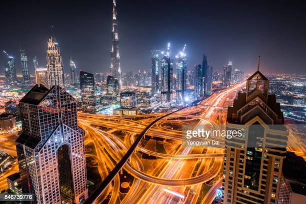 Aerial View of a Busy Road Intersection in Dubai at Night