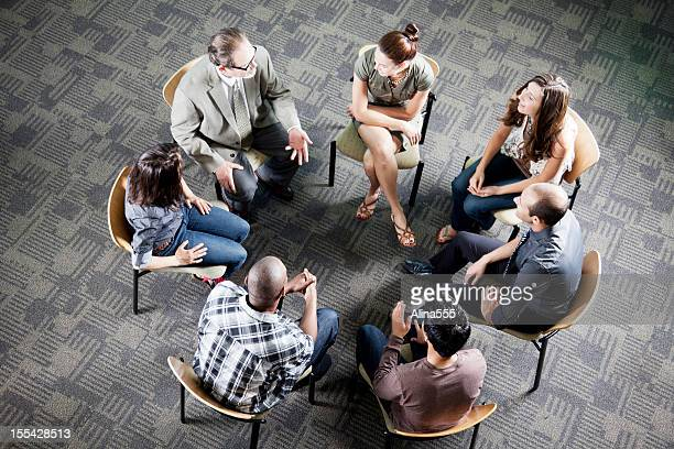 Aerial view of a diverse group sitting in a circle