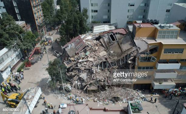 TOPSHOT Aerial view of a flattened building in Mexico City taken on September 20 2017 as the search for survivors continues a day after a strong...