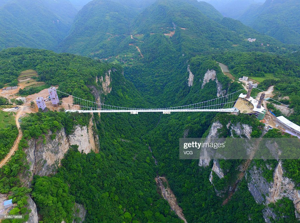 Aerial view of a glassbottomed bridge built over a 980ft valley of Zhangjiajie Grand Canyon on May 17 2016 in Zhangjiajie Hunan Province of China A...