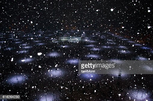 Aerial view of a lightened park in snow : Stock Photo