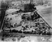 Aerial view of a MetroGoldwynMayer film studio backlot Culver City California early 1950s Visible are a number of sets from various films including...