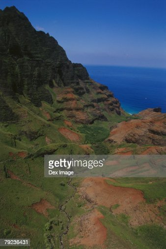 Aerial view of a mountainous cliff bordering the ocean, Kauai, Hawaii : Stock Photo