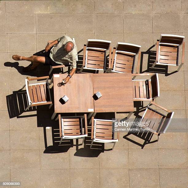 Aerial view of a person sitting on a terrace
