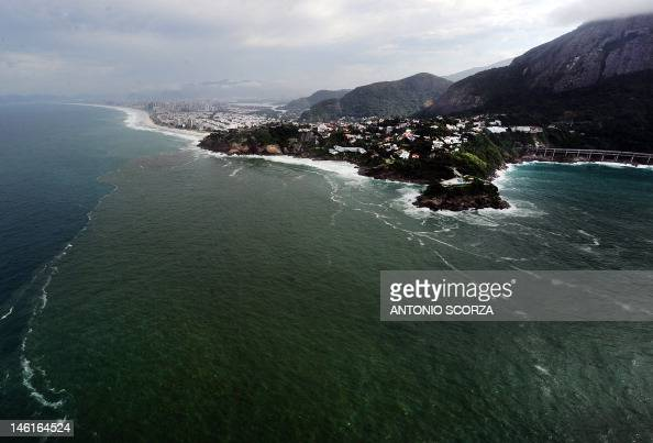 Aerial view of a pollution slick on the seawaters off the Sao Conrado and Barra da Tijuca exclusive areas on June 5 2012 in Rio de Janeiro Brazil The...