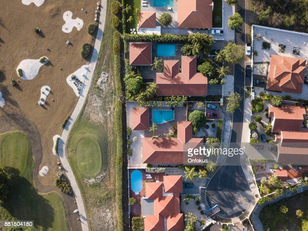 Aerial View of a Residential Area and Golf Course in Curacao
