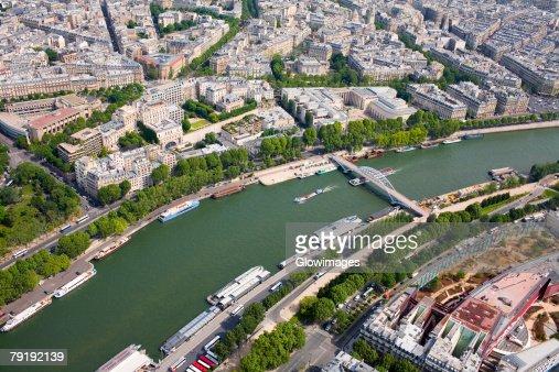 Aerial view of a river passing through a city, Passerelle Debilly, Seine River, Paris, France : Foto de stock