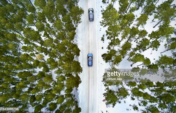 Aerial View Of A Road In Winter Forest