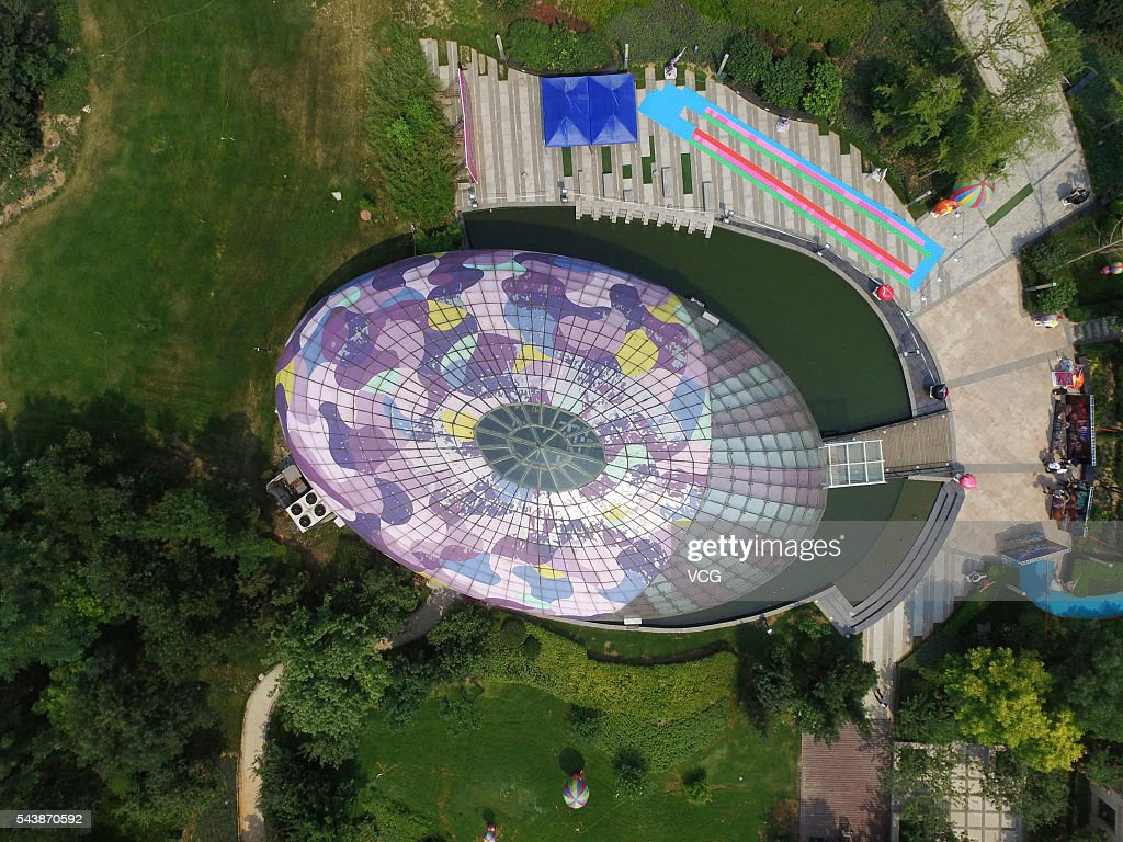 Aerial view of a sales pavilion which is built like an color egg at Qiaoxi District on June 30, 2016 in Xingtai, Hebei Province of China. The sales pavilion that seemed to be an egg from exterior view was scheduled as 'City Color' (means a colorful city)by its designer from the beginning.