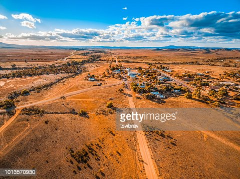 Aerial view of a small town in vast plains of South Australian outback : Stock Photo