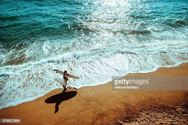 Aerial view of a surfer girl