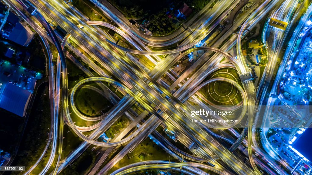 Aerial view of a Unique City Roads and Interchanges, Bangkok Expressway top view, Top view over the highway, expressway and motorway at night Aerial view from drone : Stock Photo