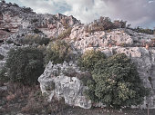 "Aerial view recorded by a drone of a wall in the ""Cava"", a natural cave in Sicily"