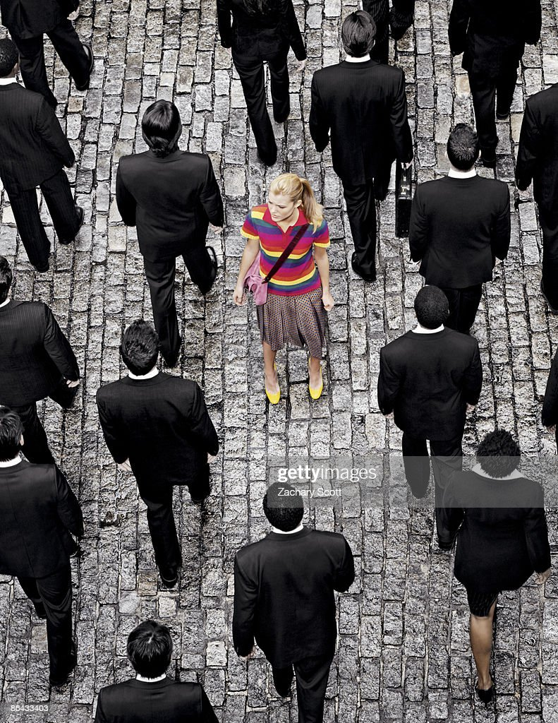 Aerial view of a Woman 'Standing out' on a street : Stock Photo