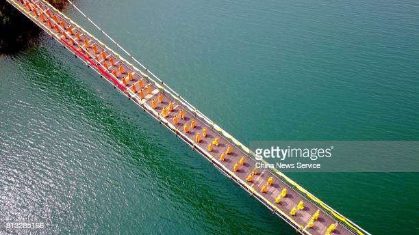 Aerial view of about one thousand Chinese monks moving forward on a suspended bridge for blessing ceremony on July 12 2017 in Nanyang Henan Province...