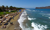 Aerial view of Agia Marina beach with big waves on July 16 2015 in Chania Greece Agia Marina is the largest touristy resort of Western Crete and its...