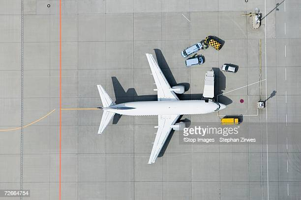 Aerial view of airplane and vans