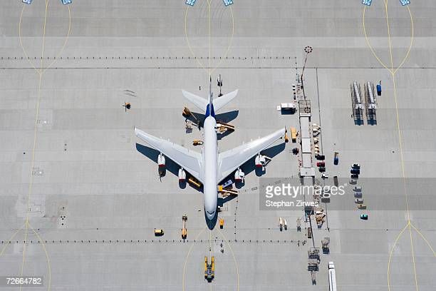 Aerial view of airplane on tarmac