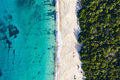 Aerial view of an amazing wild beach bathed by a transparent and turquoise sea. Sardinia, Italy.'t