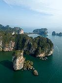 Aerial photo of Ao Nang coastline in Krabi, Thailand. Beautiful green limestone rocks and resort sand beach.