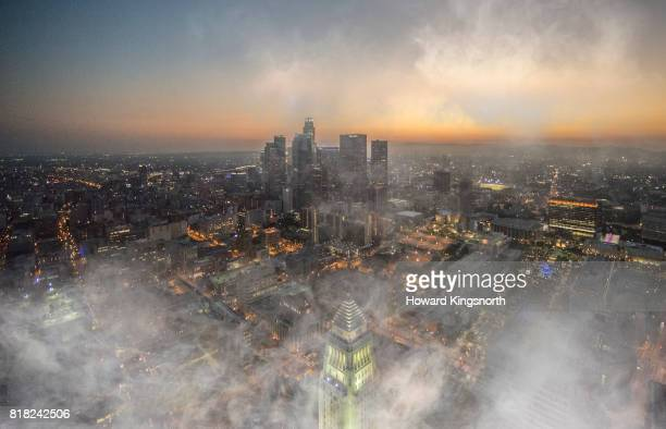 Aerial view of LA at night with misty sky