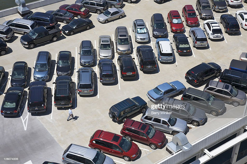 Aerial view of automobiles parked in symmetrical pattern : Stock Photo