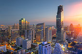 Aerial view of Bangkok modern office buildings, condominium in Bangkok city downtown,Mahanakorn tower with sunset sky , Bangkok , Thailand