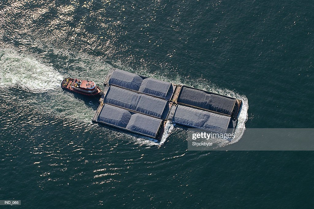 Aerial view of barge moving freight