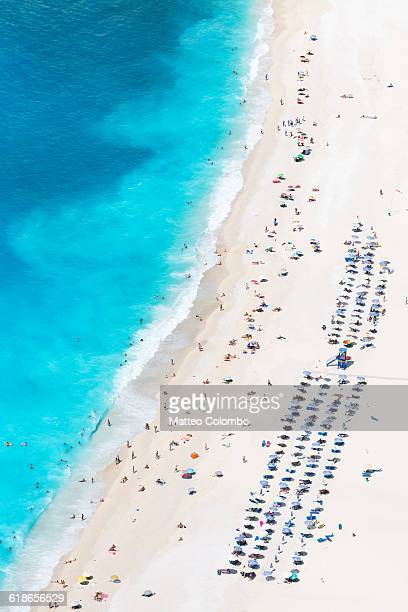 Aerial view of beach crowded with people in summer