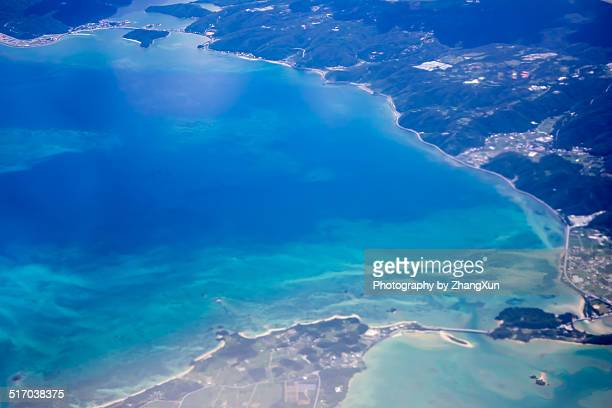 Aerial view of blue tropical water and coastline