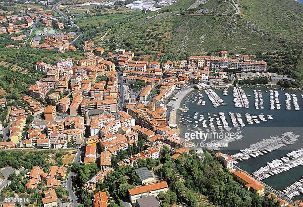 Aerial view of boats moored at a harbor Porto Ercole Monte Argentario Tuscany Italy