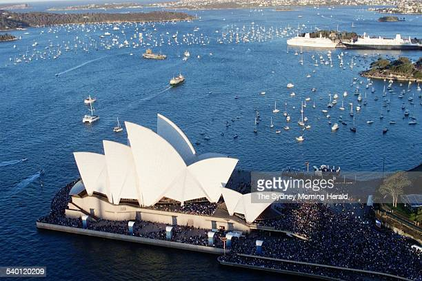 Aerial view of boats on Sydney Harbour near the Sydney Opera House gathered to watch fireworks over the city during the Sydney Olympics 1 October...
