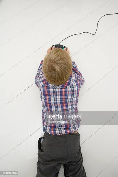 Aerial view of boy playing video game