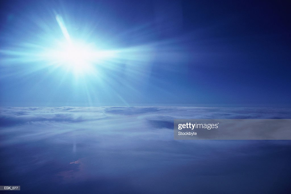 Aerial view of bright sun over cloud blanket : Stock Photo