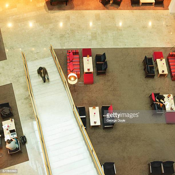 Aerial view of businessman walking upstairs in hotel foyer
