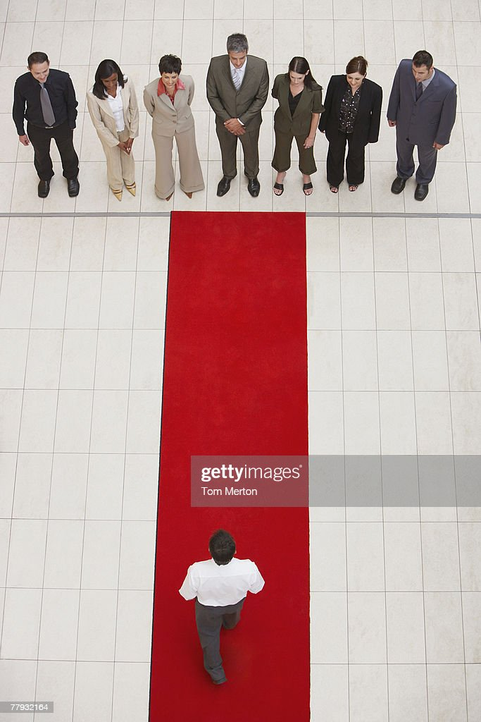 Aerial view of businesspeople and man on red carpet : Stock Photo