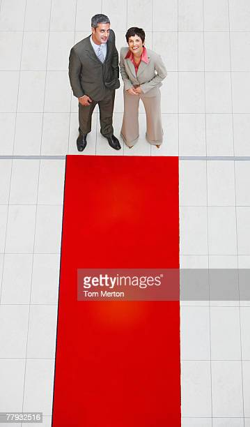 Aerial view of businesswoman and man with red carpet