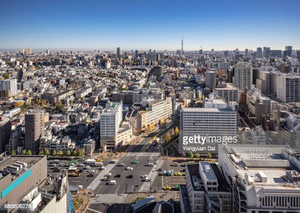 Aerial View of Busy Traffic and Crowded Buildings in Tokyo