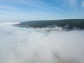 Fog drifts across the beautiful northern California coastline in Sonoma. Thick fog, generated by a layer of cool, coastal air trapped beneath a layer or warm, dry air, is common in this scenic region.