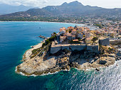 Aerial view of Calvi city, Corsica, France. Walls of the city, cliff overlooking the sea