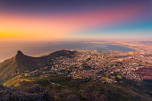 A late afternoon picture of Cape Town, South Africa taken from the Table Mountain National Park just before the sunset. At the picture you can see almost all Cape Town including the Lion's Head Mounta