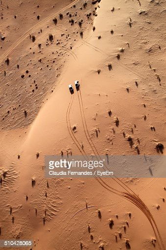 Aerial view of cars driving through desert