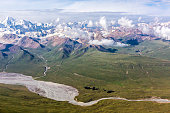 Aerial View of Asian Landscape with Desert Grassy Meadow Steppe River Stream and High Altitude Snowbound Mountains
